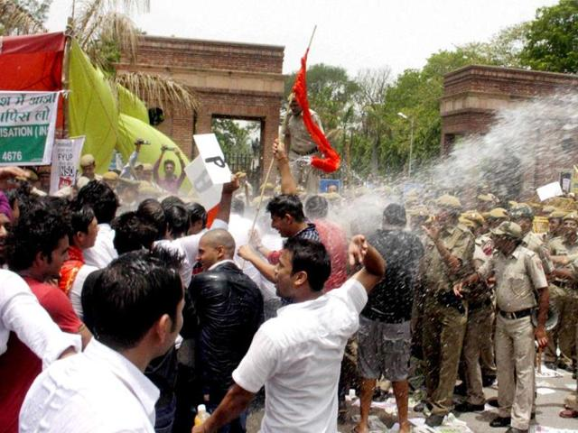 Police in action against ABVP activists during a protest over the four-year undergraduate programme (FYUP) of Delhi University in New Delhi. (PTI Photo)