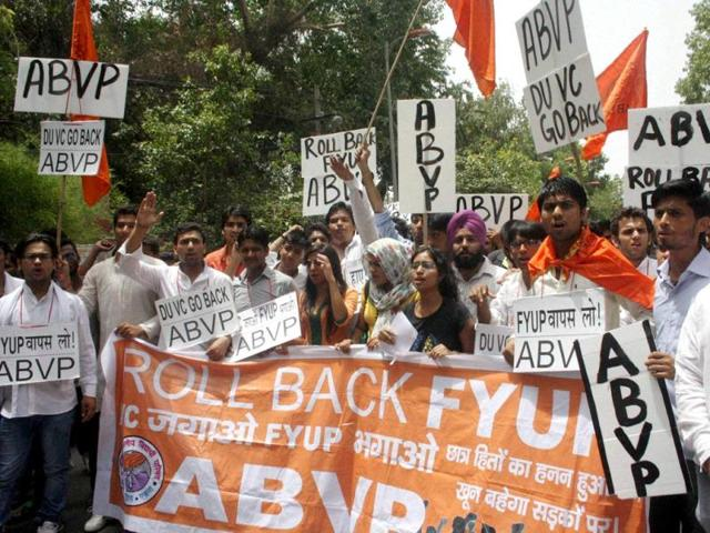 ABVP activists protest against the four-year undergraduate programme (FYUP) of Delhi University in New Delhi. (PTI Photo)