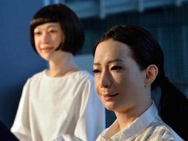 The-new-humanoid-robots-named-Otonaroid-R-and-Kodomoroid-R-are-pictured-during-a-press-preview-at-the-National-Museum-of-Emerging-Science-and-Technology-in-Tokyo-Photo-AFP-Yoshikazu-Tsuno