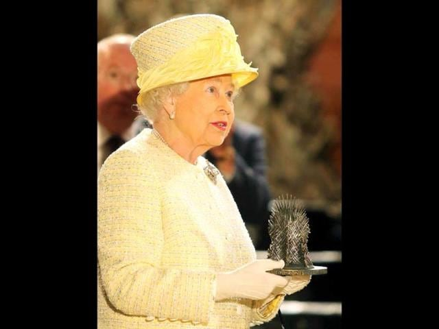 The Queen holds a momento (a miniature version of the Iron Throne). Guess the fans will have to make do with this. (Photo: AFP)