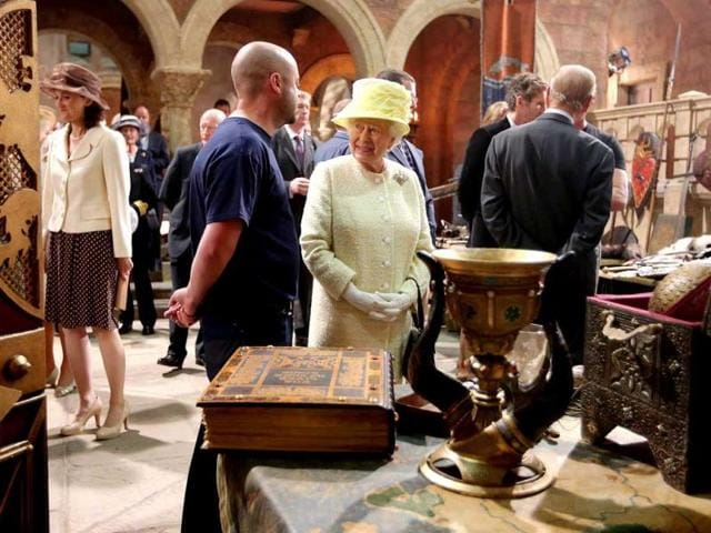 Here she views the props used in the production of the show. (Photo: AFP)