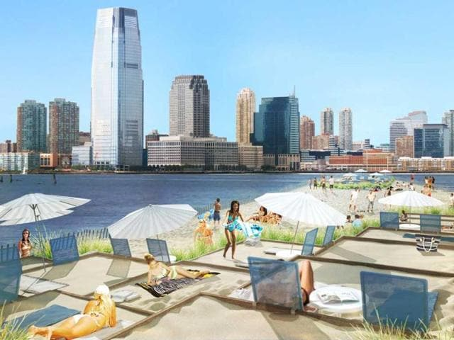 City-Beach-is-New-York-s-first-floating-beach-docked-along-side-the-shore-line-of-Manhattan-complete-with-changing-rooms-lounge-chairs-and-boardwalk-AFP