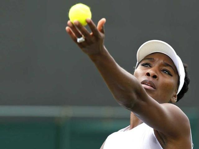 Venus-Williams-serves-to-Kurumi-Nara-during-their-women-s-singles-match-at-the-All-England-Lawn-Tennis-Championships-in-Wimbledon-London-on-Wednesday-AP-Photo