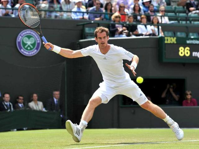 Britain-s-Andy-Murray-returns-against-Slovenia-s-Blaz-Rola-during-their-men-s-singles-second-round-match-on-Day-3-of-the-2014-Wimbledon-Championships-at-The-All-England-Tennis-Club-in-Wimbledon-AFP-Photo