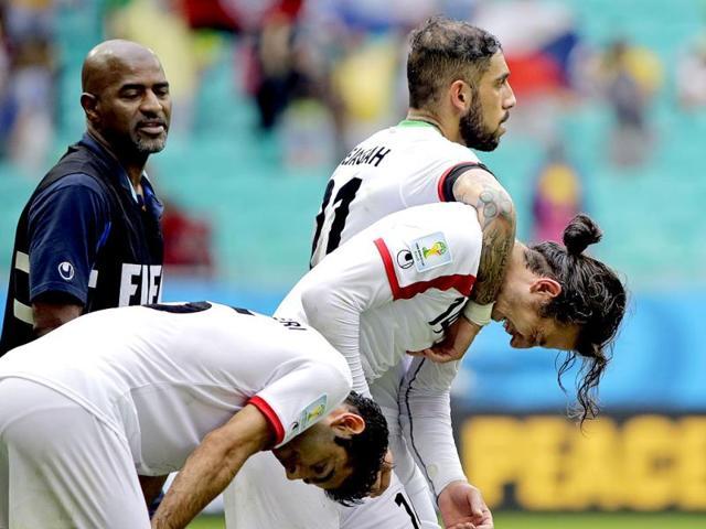 Iran-s-Ashkan-Dejagah-top-consoles-Andranik-Teymourian-after-the-Group-F-World-Cup-match-between-Bosnia-and-Iran-at-the-Arena-Fonte-Nova-in-Salvador-Brazil-on-Wednesday-Bosnia-won-the-match-3-1-AP-Photo