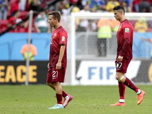 Portugal-s-Cristiano-Ronaldo-right-and-Joao-Pereira-leave-the-pitch-after-the-Group-G-World-Cup-match-between-Portugal-and-Ghana-at-the-Estadio-Nacional-in-Brasilia-Brazil-on-Thursday-Ronaldo-s-first-goal-of-the-World-Cup-earned-Portugal-a-2-1-win-over-Ghana-but-couldn-t-prevent-his-team-being-eliminated-from-the-tournament-along-with-the-Africans-AP-Photo