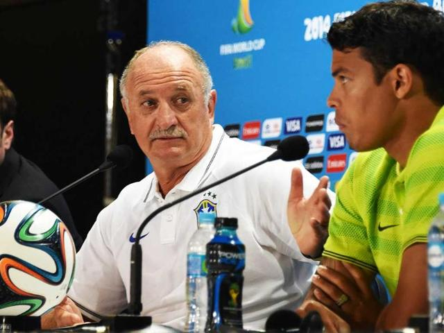 Brazil-s-coach-Luiz-Felipe-Scolari-L-speaks-as-defender-and-captain-Thiago-Silva-R-listens-during-a-press-conference-at-Mineirao-stadium-in-Belo-Horizonte-AFP-Photo