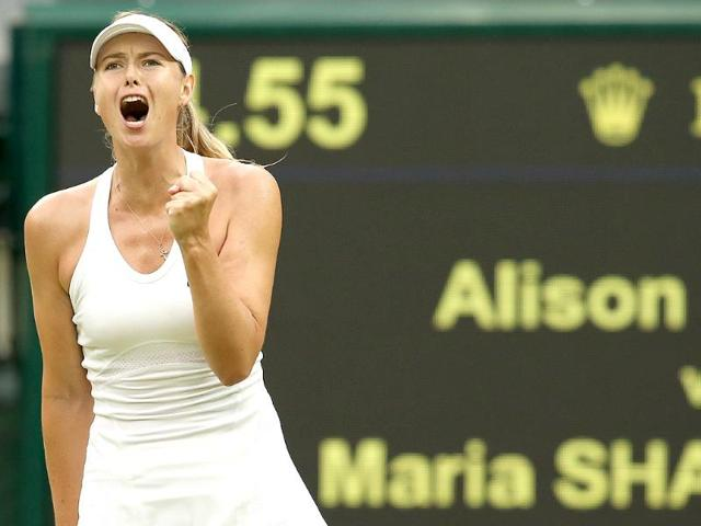 Maria-Sharapova-reacts-to-winning-a-point-against-Alison-Riske-during-their-women-s-singles-third-round-match-on-day-six-of-the-2014-Wimbledon-Championships-at-The-All-England-Tennis-Club-in-Wimbledon-AFP-Photo
