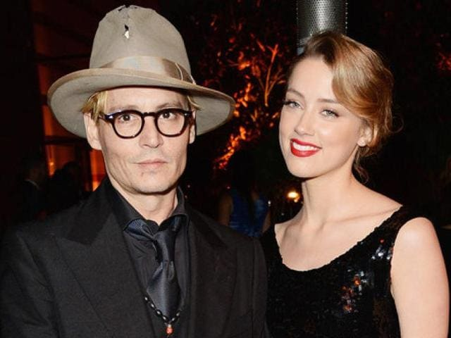 Actor Johnny Depp's slurry speech at the Hollywood Film Awards seems to have cost him a lot. His fiance Amber Heard is said to have slowed down their wedding plans as she was reportyedley