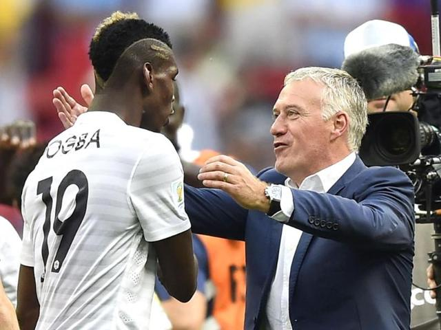 France-s-coach-Didier-Deschamps-right-celebrates-with-France-s-midfielder-Paul-Pogba-after-a-Round-of-16-football-match-between-France-and-Nigeria-at-Mane-Garrincha-National-Stadium-in-Brasilia-AFP-Photo