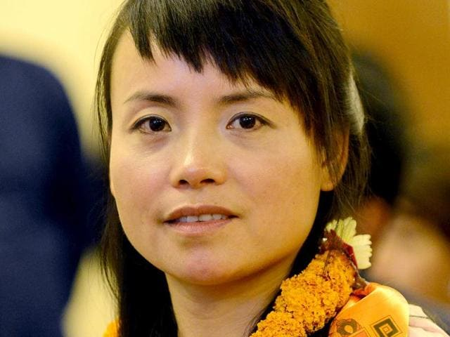 Chinese-mountaineer-Wang-Jing-the-only-climber-to-scale-Mount-Everest-from-Nepal-side-this-season-looks-on-during-an-event-to-celebrate-her-ascent-in-Kathmandu-AFP-photo