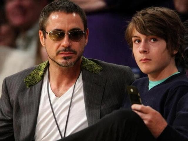 Robert-Downey-Junior-and-his-son-Indio-Downey-attend-a-basketball-game-in-Los-Angeles-in-2008-Getty-Images