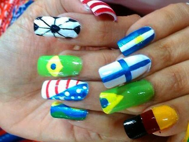 Girls-sporting-football-inspired-nail-art-which-is-fast-catching-up-among-the-youth-IANS-Photo