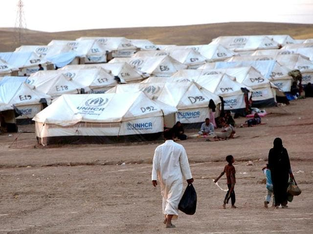 An Iraqi family fleeing violence in the northern city of Tal Afar, arrive at the Kurdish checkpoint in Aski kalak, 40 km West of Arbil, in the autonomous Kurdistan region. Saudi Arabia pledged $500 million in humanitarian aid for Iraq to be disbursed through the United Nations to those in need regardless of sect or ethnicity, state media reported. (AFP photo)
