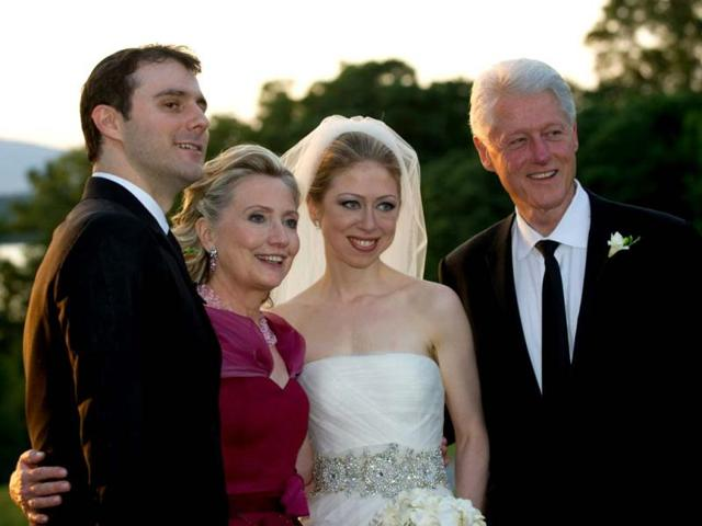 A-file-photo-of-Bill-Clinton-Hillary-Clinton-their-daughter-Chelsea-and-her-husband-Marc-Mezvinsky-AP