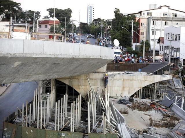 A-worker-walks-up-a-ladder-on-a-bridge-that-collapsed-in-Belo-Horizonte-AP-Photo