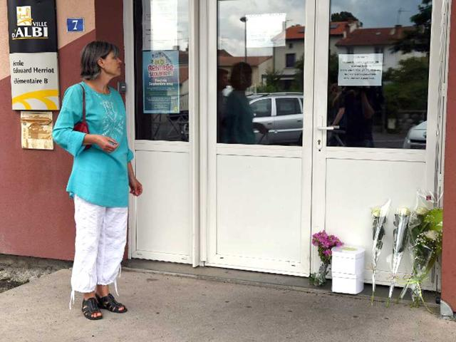 A-woman-stands-in-front-of-the-entrance-of-the-primary-school-Edouard-Herriot-where-a-female-teacher-was-stabbed-to-death-in-front-of-her-pupils-by-a-student-s-mother-in-the-southern-French-town-of-Albi-AFP-Photo