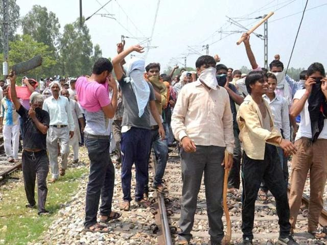 BJP-mahapanchayat-supporters-during-a-clash-at-Kanth-Railway-Station-in-Moradabad-district-PTI-photo