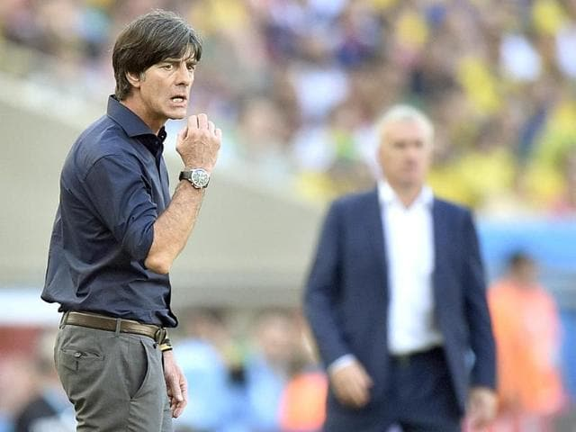 Germany-coach-Joachim-Loew-L-and-France-s-Didier-Deschamps-stand-on-the-touchline-during-the-World-Cup-quarter-final-match-between-at-the-Maracana-Stadium-in-Rio-de-Janeiro-AP-Photo