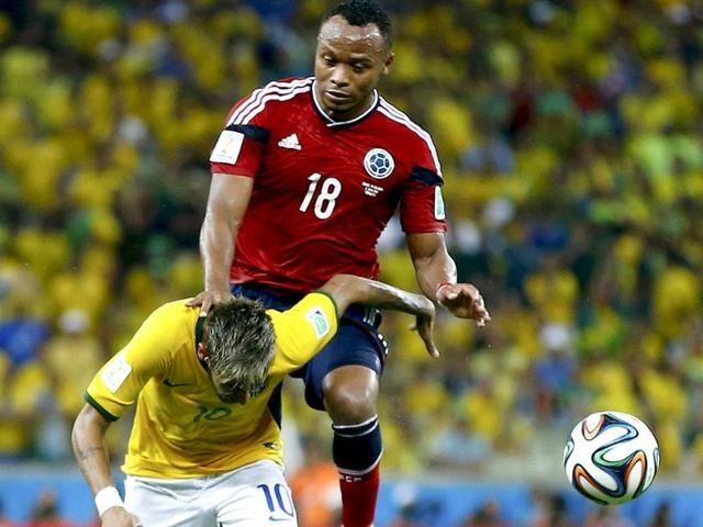 Juan-Zuniga-drives-his-knee-into-Neymar-s-back-AP-Photo