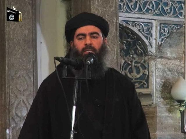 An-image-grab-taken-from-a-propaganda-video-released-on-July-5-2014-by-al-Furqan-Media-allegedly-shows-the-leader-of-the-Islamic-State-IS-jihadist-group-Abu-Bakr-al-Baghdadi-aka-Caliph-Ibrahim-adressing-Muslim-worshippers-at-a-mosque-in-the-militant-held-northern-Iraqi-city-of-Mosul-AFP-Photo
