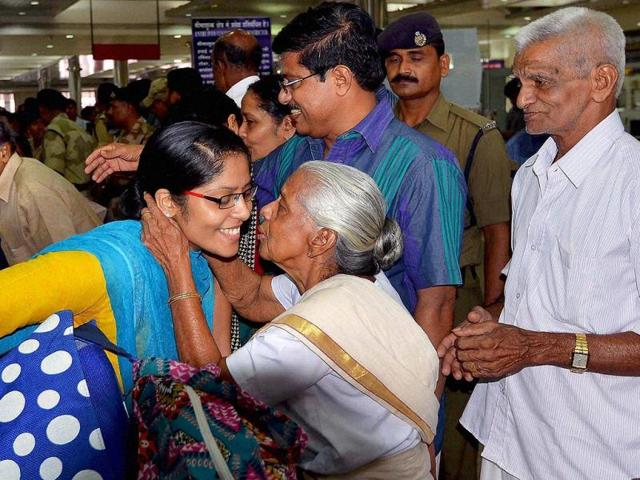 Relatives-of-an-Indian-nurse-hug-greet-her-upon-her-return-from-an-area-in-Iraq-seized-by-Islamic-State-militants-last-year-at-Kochi-airport-Poor-work-conditions-at-home-and-small-returns-force-hundreds-of-nurses-to-flee-to-volatile-countries-where-they-are-promised-at-least-five-times-more-than-what-an-Indian-hospital-would-offer-AFP-File-Photo