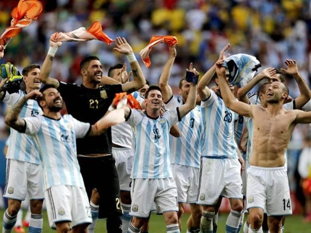 Argentina-s-Lionel-Messi-and-teammates-celebrate-at-the-end-of-the-World-Cup-quarter-final-match-between-Argentina-and-Belgium-at-the-Estadio-Nacional-in-Brasilia-Brazil-Argentina-won-1-0-AP-Photo