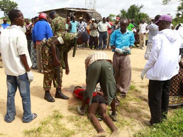 Policemen-recover-the-slain-body-of-a-man-killed-when-gunmen-attacked-Hindi-village-near-Kenya-s-coastal-town-of-Lamu-Reuters-photo