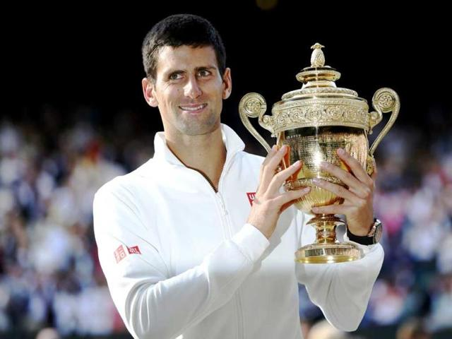 Novak-Djokovic-of-Serbia-holds-the-winners-trophy-after-defeating-Roger-Federer-of-Switzerland-in-their-men-s-singles-final-tennis-match-at-Wimbledon-in-London-Reuters-Photo