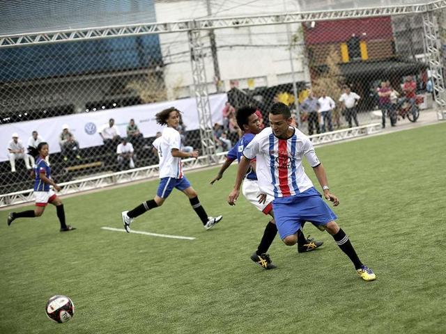 Players-from-Costa-Rica-and-the-Philippines-in-blue-shirts-compete-in-a-football-match-during-the-Street-Soccer-World-Cup-in-Sao-Paulo-The-Street-Soccer-World-Cup-kicked-off-on-Monday-in-Brazil-s-biggest-city-with-players-from-two-dozen-nations-across-the-world-all-linked-to-movements-seeking-social-change-Reuters-Photo