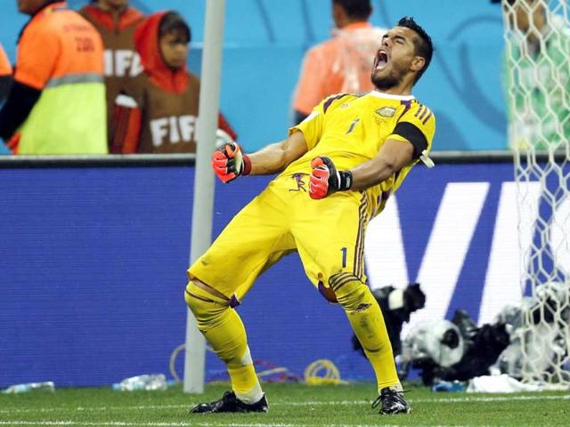 Argentina-s-goalkeeper-Sergio-Romero-reacts-after-saving-a-shot-by-Wesley-Sneijder-in-the-penalty-shootout-AP-Photo