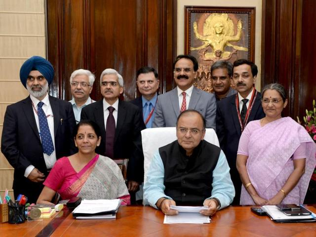 Union-finance-minister-Arun-Jaitley-C-poses-with-members-of-his-team-for-a-group-photograph-on-the-eve-of-the-presentation-of-the-the-Annual-Budget-2014-15-in-Parliament-AFP-Photo