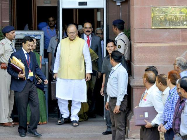 Finance minister Arun Jaitley with MOS Nirmala Sitharaman and secretaries leave North Block to present union budget in Parliament. (HT photo/Mohd Zakir)