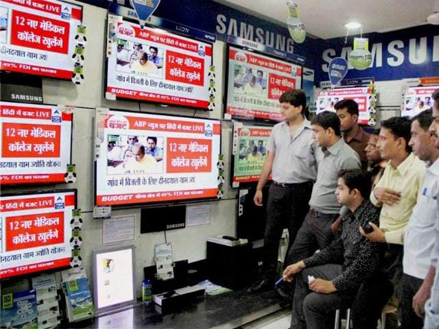 People watch live telecast of general budget 2014-2015 on TV sets in Allahabad. (PTI photo)