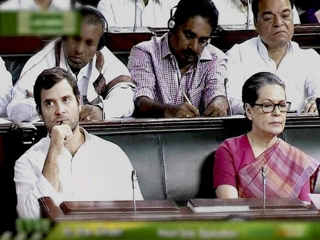 Congress president Sonia Gandhi and party vice president Rahul Gandhi during presentation of the union budget 2014-15 in the Lok Sabha in New Delhi. (PTI photo)