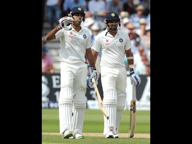 Bhuvneshwar-Kumar-L-signals-for-a-drinks-break-with-batting-partner-Mohammed-Shami-during-day-two-of-the-first-Test-against-England-at-Trent-Bridge-Nottingham-England-AP-Photo