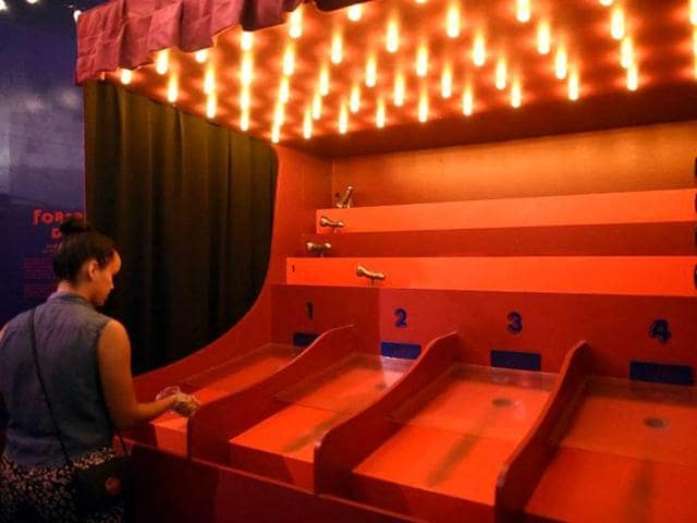 A-visitor-plays-in-the-Bompas-amp-Parr-Foreplay-Derby-part-of-Funland-Pleasures-amp-Perils-of-the-Erotic-Fairground-at-the-Museum-of-Sex-in-New-York-AFP