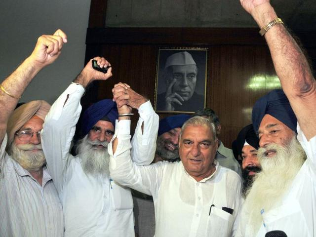 Haryana-cheif-minister-Bhupinder-Singh-Hooda-HSGPC-president-Jagdish-Singh-Jhinda-ad-hoc-with-secretary-Didar-Singh-Nalvi-celebrating-after-the-state-assembly-passed-the-bill-for-separate-separate-body-to-manage-affairs-of-Sikh-shrines-at-assembly-premises-in-Chandigarh-on-Friday-Keshav-Singh-HT-Keshav-Singh-HT