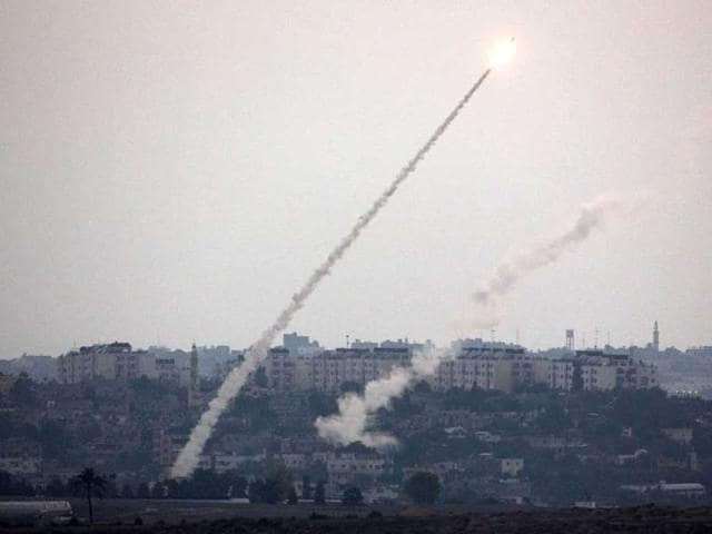 A picture taken from the southern Israeli Gaza border shows a rocket being launched from the Gaza strip into Israel (AFP Photo)