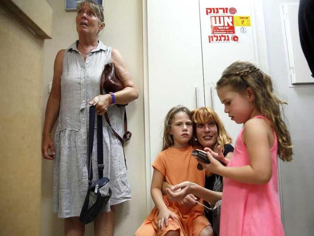 Israelis take cover in a police station during a rocket attack by Palestinian militants from the Gaza Strip. (AFP Photo)