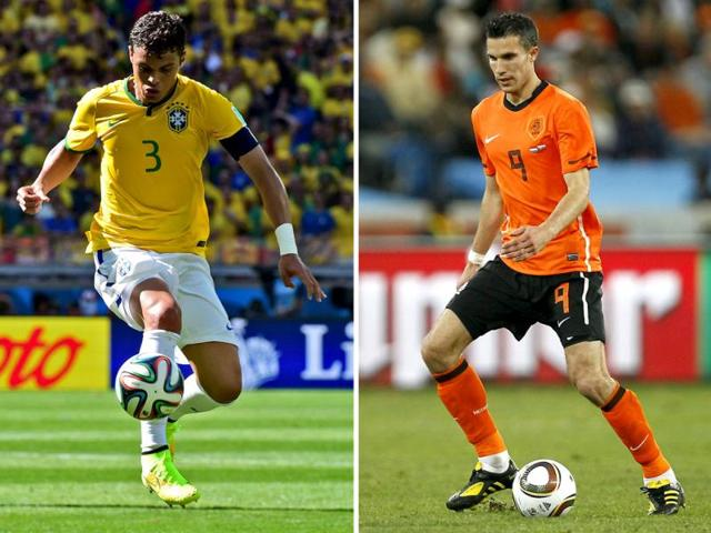 A-combination-of-file-pictures-shows-Netherlands-striker-and-captain-Robin-van-Persie-R-and-Brazil-defender-and-captain-Thiago-Silva-AFP-Photo