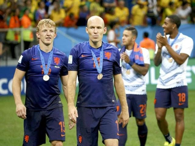 Dirk-Kuyt-L-and-Arjen-Robben-of-the-Netherlands-walk-with-their-medals-after-the-World-Cup-third-place-playoff-against-Brazil-at-the-Brasilia-national-stadium-Reuters-Photo