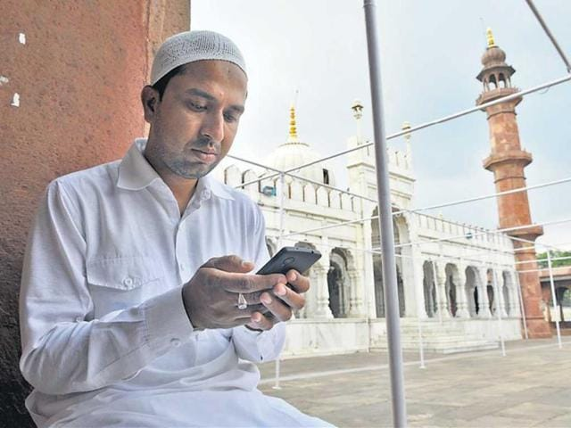 A-youth-reads-holy-text-on-his-cellphone-at-Moti-Masjid-in-Bhopal-HT-photo