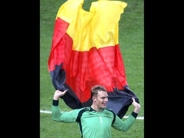 Germany-s-goalkeeper-Manuel-Neuer-celebrates-with-a-national-flag-after-winning-the-2014-World-Cup-final-against-Argentina-at-the-Maracana-stadium-in-Rio-de-Janeiro-Reuters-Photo