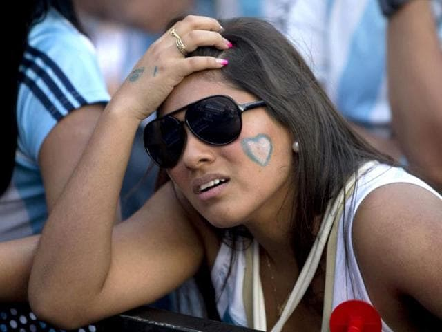 An-Argentina-supporter-reacts-before-the-match-between-Argentina-and-Bosnia-at-the-Maracana-Stadium-in-Rio-de-Janeiro-Brazil-AP-Photo