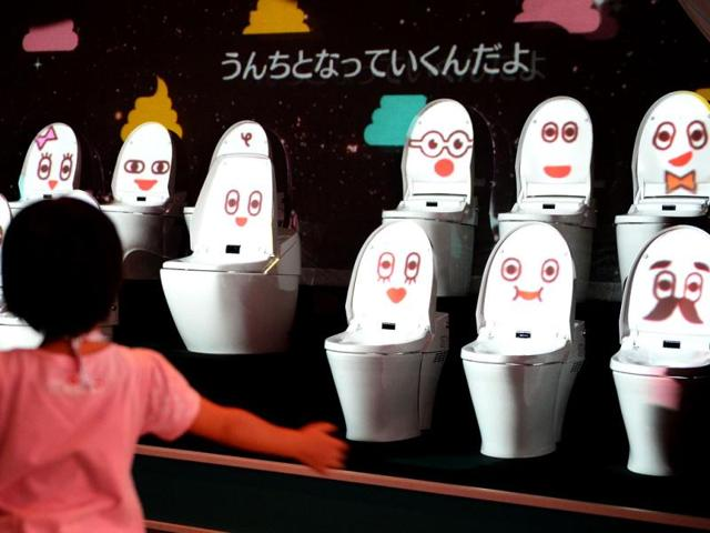A-child-dances-as-she-listens-to-a-song-by-toilet-bowls-at-a-toilet-exhibition-at-the-National-Museum-of-Emerging-Science-and-Innovation-in-Tokyo-AFP