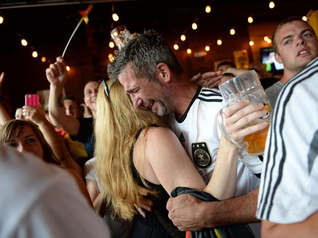 Simon Vogt, of Germany celebrates with his girlfriend, Leslie Wilber after the World Cup soccer final in Brazil between Germany and Argentina, at Wolff