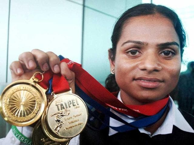 Odiya-athlete-Dutee-Chand-shows-her-medals-won-at-the-Asian-Junior-Atheletic-meet-in-Taipei-PTI-Photo