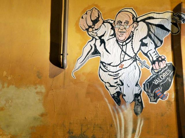 A-view-of-a-street-art-mural-by-Italian-street-artist-Maupal-which-depicts-Pope-Francis-as-a-superman-AFP