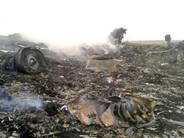 An-emergencies-ministry-member-works-at-the-crash-site-of-MH17-Reuters-photo